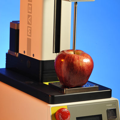 Photograph of a package compression or burst testing equipment